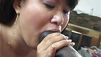 Big-boobied Asian slut that is black pumps her huge size tits