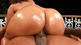 chick oils up her big round ass with egg on her pussy