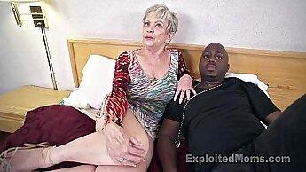 Busty mature whore takes three black cocks
