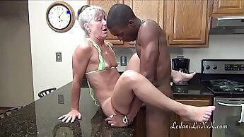 MILF giving blowjob in the kitchen with facial