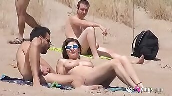 Beach girl masturbates with a dildo